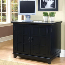 Home Styles - Home Styles Arts and Crafts Compact Computer Armoire - Black - 5181-19 - Shop for File and Storage Cabinets from Hayneedle.com! The space-saving design of the Home Styles Arts and Crafts Compact Computer Armoire - Black makes it a perfect fit for any home office. This computer desk is built with hardwood solids and engineered wood. It has an attractive black multi-step finish ending in a clear coat to protect it from normal wear and tear. Assembly is easy and detailed instructions are included.This computer armoire gives you plenty of storage in a compact space. It has a compartment for your CPU a retractable keyboard tray with ball-bearing drawer guides and a printer shelf. The pull out file drawer can accommodate either letter- or legal-size files and the utility drawer is perfect for storing smaller office items. A space below the utility drawer features an adjustable shelf to add to the storage space. The cabinet doors swing all the way back to fit flush against the unit.Additional Features:Full-extension drawer guides on keyboard trayDoors fit flush against unit when openDimensions:CPU compartment: 9.75W x 21D x 18.5H inchesKeyboard tray: 32W x 15D x 1.75H inchesPrinter shelf: 23.25W x 20.75D x 8.25H inchesFile drawer: 21.25W x 18.5D x 10H inchesSmall drawer: 7.75W x 14.5D x 2.25H inchesAbout Home StylesHome Styles is a manufacturer and distributor of RTA (ready to assemble) furniture perfectly suited to today's lifestyles. Blending attractive design with modern functionality their furniture collections span many styles from timeless traditional to cutting-edge contemporary. The great difference between Home Styles and many other RTA furniture manufacturers is that Home Styles pieces feature hardwood construction and quality hardware that stand up to years of use. When shopping for convenient durable items for the home look to Home Styles. You'll appreciate the value.