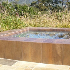 Eclectic Hot Tub And Pool Supplies by Village Pool Builders