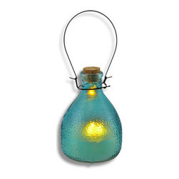 Glass LED Flickering Candle Lantern Blue - This unique lantern will add some country charm to your home. The flickering candle looks like it's melting right inside the jar! It has a raised pattern on the outside of the glass designed to appear warm to the touch. Hang it from a hook in your garden, or set several on a table for a fanciful candlelit dinner. The options are endless. Uses one CR2032 lithium cell 3 volt battery (included) for worry free 'burning'. The lantern is 5 1/2 inches tall, 9 inches tall with the metal handle and 4 inches wide.