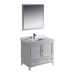 "Fresca - Fresca Oxford 36"" Antique White Vanity - Dimensions of vanity:  36""W x 20.38""D x 32.63""H. Dimensions of mirror:  31.88""W x 31.88""H. Materials:  Solid wood frame, MDF panels, quartz stone countertop, ceramic undermount sink w/ overflow. Single hole faucet mount. 2 soft close doors. Soft close dovetail drawer. Seamless countertop w/ matching backsplash. P-trap, faucet, pop-up drain and installation hardware included. Blending clean lines with classic wood, the Fresca Oxford traditional bathroom vanity is a must-have for modern and traditional bathrooms alike.  The vanity frame itself features solid wood in a stunning antique white finish that's sure to stand out in any bathroom and match all interiors.   Available in many different finishes and configurations."