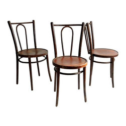 "Pre-owned Berc Antoine Parisian Cafe Chairs - Set of 3 - Romantic Parisian cafe chairs from Berc Antoine, an historic French workshop founded in 1892. These bentwood bistro chairs have rounded seats with an Art Nouveau decoration of an iris, the French national flower. These charming little chairs are in marvelous condition, considering their age. The seller has freshened the chairs, but have not disturbed the original finish. Seat height: 19"".    The label reads:  Tout le materiel de cafe  BERC ANTOINE  10 ET 12 Boulevard Richard-Lenoir  Paris - XI  Tel. 700-41-63"