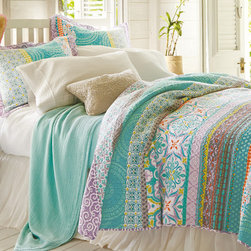 Positano Quilt - Inspired by the dramatic splendor of this town on Italy's Amalfi coast, our Positano quilt is an exotic mix of color and pattern.