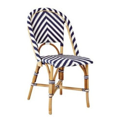 Serena & Lily - Chevron Riviera Side Chair Navy - What could be better than our timeless Riviera Chair? The same sleek frame (inspired by the bistros of 1930s Europe) in a bold new chevron pattern. We love the classic colour mix, too a rich shade against a crisp white. Handcrafted of sustainable rattan with a woven plastic seat and back, it's great inside or in the garden. Look closely and you'll notice the wonderfully organic marks created while bending and stretching the rattan into shape a time-honored technique perfected by the French. Try it with the other silhouettes in this collection. A slight variation in how the colors are woven keeps things interesting.   View dimensions