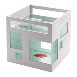 Umbra - Umbra Fishhotel Aquarium - The Umbra Fish Hotel aquarium is an award-winning modern home for your finned friends. Modeled after contemporary architecture, this reinvented aquarium features a sleek geometric design with assymetrical 'windows. ' Units can be stacked and lined up side-by-side to create a condominium effect. Glass liner is removable for cleaning. Openings on either side provide handles for easy transport when cleaning, and ventilation for the lower unit when stacked.