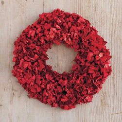 "Viva Terra - Red Hydrangea Wreath - Introducing our ingenious and seasonally stunning alternative to poinsettias: a hydrangea wreath on a grapevine base. Our floral designer grows his own hydrangeas by the ocean, then sun-bleaches the cut flowers and enhances them with food coloring. Glycerin keeps the petals pliable and adds a soft radiance to the wreath. Whether used as a centerpiece or hung on a wall or door, we suspect you'll want to save and store it for seasons to come. WREATH 15""DIAM, HANGER 13""L"