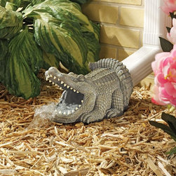 Design Toscano - Design Toscano Alligator Decorative Garden Downspout Collection Multicolor - EU3 - Shop for Sculptures Statues and Figurines from Hayneedle.com! The Design Toscano Alligator Decorative Garden Downspout Collection takes those rainstorms on with a bit of fun. Made to last for years from high-quality resin this alligator is a great way to protect your foundation. It is hand-painted for a life-like look and is packed with detail.About Design ToscanoDesign Toscano is the country's premier source for statues and other historical and antique replicas which are available through the company's catalog and website. Design Toscano's founders Michael and Marilyn Stopka created Design Toscano in 1990. While on a trip to Paris the Stopkas first saw the marvelous carvings of gargoyles and water spouts at the Notre Dame Cathedral. Inspired by the beauty and mystery of these pieces they decided to introduce the world of medieval gargoyles to America in 1993. On a later trip to Albi France the Stopkas had the pleasure of being exposed to the world of Jacquard tapestries that they added quickly to the growing catalog. Since then the company's product line has grown to include Egyptian Medieval and other period pieces that are now among the current favorites of Design Toscano customers along with an extensive collection of garden fountains statuary authentic canvas replicas of oil painting masterpieces and other antique art reproductions. At Design Toscano attention to detail is important. Travel directly to the source for all historical replicas ensures brilliant design.