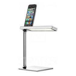 """Flos - Flos D'E-light Table Lamp - LED desk lamp with charging device for various portable devices. Head in aluminium, stem in extruded aluminium, base in zamak to increase stability, chrome-plated or matte black finish.     The D'E-light Table Lamp from FLOS is the best lighting device for those seeking a perfect link of modern design, task lighting, and functionality. With an aluminum head, extruded aluminum stem, and zamak base (for increased stability), D'e Light features a dedicated charging station. Select a compatible charging connector in options.  D'e Light provides an oriented light flow that gives unrivaled lighting comfort. Features an Optical On/Off switch with Soft Touch technology and light flow adjustment to 2 intensities (100% - 50% - 0%). Offered in chrome or matte black finish.  Please select the appropriate model for your device and enter in comments please:  - Apple 30-pin connector works with: iPhone (up to version 4), iPad (version 1 & 2), and iPods - Apple Lightning connector works with: iPhone (5 and later), iPad (retina display), and iPad Mini - mini-USB connector works with: all non-Apple devices including HTC, BlackBerry, Samsung Galaxy, Google Nexus  Note: Pictures of iPhone, iPad, and iPod are used with the only purpose of describing the functionality of D'E-light. All rights on trademarks and products like iPhone, iPad, and iPod are of exclusive property of the manufacturer, and are not referable to Flos or its affiliates. LEGAL NOTICE: iPad, iPhone and iPod are trademarks of Apple Inc., registered in the U.S. and other countries.     Manufacturer: FLOS   Designer:  Philippe Starck   Made in:  Italy   Dimensions:   Base: 4.7"""" (11.9 cm) x Height: 12.5"""" (31.7 cm) x Head: 8.5"""" (21.6 cm)     Lamping:   14 X 5W 120V LEDs 2700K, 85 CRI, 299 lumens (included)     Material: Aluminum"""
