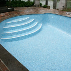 Aqua blue glass tile - Pool renovation with light blue aqua glass tive over existing marcite. 20 years warranty both material & installation