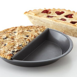 "Split Decision Pie Pan - For the indecisive pie baker, there's finally a resolution. The really indecisive can always get two. This also works well to stop sibling rivalry at the holiday table before it even starts (""Mom likes me better, she made my favorite pie!"")."
