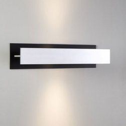 "Track Wall Lamp - The Track Wall Lamp has been designed by Jos Muller for Quasar. This fixture is composed of Aluminium polished with black details. Available in one finish option Aluminium. Illumination is provided by 1 X 12W LED Citizen 2700K Halogen Bulb (not included).  Product Details:    The Track Wall Lamp has been designed by Jos Muller for Quasar. This fixture is composed of Aluminium polished with black details. Available in one finish option Aluminium. Illumination is provided by  1 X 12W LED Citizen 2700K Halogen Bulb (not included).   Details:     Manufacturer:  Quasar   Designer:  Jos Muller     Made in:  Netherlands     Dimensions:  Height: 4.7"" (12 cm) X  Width: 17.3"" (44 cm) X  Length: 4.3"" (10.9 cm)     Light bulb:   1 X 12W LED Citizen 2700K Halogen     Material:  Aluminium"