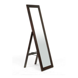 Wholesale Interiors - Lund Dark Brown Wood Modern Mirror with Built - in Stand - Svelte, stylish, and convenient, the Lund Mirror is a great way to spice up your morning routine. Made with an eco-friendly solid rubberwood frame and integrated stand, allowing the piece to be freestanding at an angle without needing to be secured or leaned against a wall. This is not a full body length mirror. To clean, the frame should be wiped with a dry cloth and the mirror itself cleaned with standard glass cleaning solution. The mirror is made in Malaysia and is fully assembled. Dimensions: 18 inches in Wide X 21.25 inches in Deep X 60.25 inches in height.