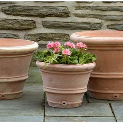 Campania International - Terra Cotta Round Classic Rolled Rim Planter - Set of 3 Multicolor - 8359-2403 - Shop for Planters and Pottery from Hayneedle.com! This set of Terra Cotta Classic Rolled Rim Planters features rounded rims and rolls around the body of the pot. Each features a traditional terra cotta color and has a drainage hole to protect plant roots from over-saturation. Constructed of high-fire terra cotta and hand-glazed with a warm finish these planters are frost-resistant for indoor and outdoor use. They bring a beautiful welcoming presence to any garden or home. Dimensions: 23.75 diam. x 16H inches; 19.75 diam. x 14H inches; and 15.75 diam. x 12H inches. Set weighs 112 pounds.Benefits of Terra CottaTerra cotta Italian for baked earth is an unglazed ceramic based from clay. The history of terra cotta includes its use in the famous Terracotta Warriors statues in China. It is widely used today in building materials such as roofing and is a favorite among gardeners to house plants. Terra cotta is useful because of its low cost versatility and durability. Because it is porous terra cotta allows water to vaporize through it which is helpful to plants especially if they have an abundance of moisture. It's gas permeable so helps maintain healthy plants. Its brownish orange color comes from iron oxide in the clay. Compared to items made from other stonework terra cotta items are much lighter in weight. Overall terra cotta makes an excellent choice in the garden.About Campania InternationalEstablished in 1984 Campania International's reputation has been built on quality original products and service. Originally selling terra cotta planters Campania soon began to research and develop the design and manufacture of cast stone garden planters and ornaments. Campania is also an importer and wholesaler of garden products including polyethylene terra cotta glazed pottery cast iron and fiberglass planters as well as classic garden structures fountains and cast resin statuary.Campania Cast Stone: The ProcessThe creation of Campania's cast stone pieces begins and ends by hand. From the creation of an original design making of a mold pouring the cast stone application of the patina to the final packing of an order the process is both technical and artistic. As many as 30 pairs of hands are involved in the creation of each Campania piece in a labor intensive 15 step process.The process begins either with the creation of an original copyrighted design by Campania's artisans or an antique original. Antique originals will often require some restoration work which is also done in-house by expert craftsmen. Campania's mold making department will then begin a multi-step process to create a production mold which will properly replicate the detail and texture of the original piece. Depending on its size and complexity a mold can take as long as three months to complete. Campania creates in excess of 700 molds per year.After a mold is completed it is moved to the production area where a team individually hand pours the liquid cast stone mixture into the mold and employs special techniques to remove air bubbles. Campania carefully monitors the PSI of every piece. PSI (pounds per square inch) measures the strength of every piece to ensure durability. The PSI of Campania pieces is currently engineered at approximately 7500 for optimum strength. Each piece is air-dried and then de-molded by hand. After an internal quality check pieces are sent to a finishing department where seams are ground and any air holes caused by the pouring process are filled and smoothed. Pieces are then placed on a pallet for stocking in the warehouse.All Campania pieces are produced and stocked in natural cast stone. When a customer's order is placed pieces are pulled and unless a piece is requested in natural cast stone it is finished in a unique patinas. All patinas are applied by hand in a multi-step process; some patinas require three separate color applications. A finisher's skill in applying the patina and wiping away any excess to highlight detail requires not only technical skill but also true artistic sensibility. Every Campania piece becomes a unique and original work of garden art as a result.After the patina is dry the piece is then quality inspected. All pieces of a customer's order are batched and checked for completeness. A two-person packing team will then pack the order by hand into gaylord boxes on pallets. The packing material used is excelsior a natural wood product that has no chemical additives and may be recycled as display material repacking customer orders mulch or even bedding for animals. This exhaustive process ensures that Campania will remain a popular and beloved choice when it comes to garden decor.Please note this product does not ship to Pennsylvania.