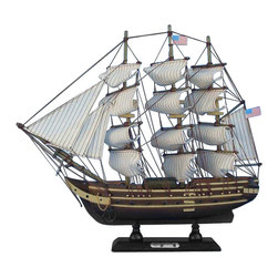"Handcrafted Model Ships - USS Constitution 15"" - Wooden Tall Ship Model - Sold Fully Assembled Ready for Immediate Display - Not a Model Ship kit. Inspired by the USS Constitution the oldest and most famous ship in the U.S. Navy still sailing today, these adorable tall ships models of ""Old Ironsides"" rests easily upon any desk or shelf. Add a touch of nautical history to the decor of any room with this tall model ship. 15"" Long x 2"" Wide x 12"" High (1:175 scale)."