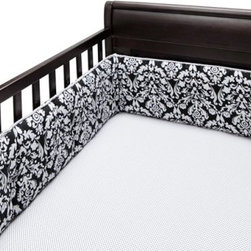 Bananafish Taylor Crib Bumper - Crib protection and style go hand in hand with the Bananafish Taylor Crib Bumper. This bumper set features a double-sided pattern of a black and white damask print. Made with soft, cozy cotton, this cushioned bumper set includes two short and two long sides that fit most crib rail formats. Its tie assembly is easy to install. Machine wash on cold for convenient cleaning.Dimensions: Short: 10W x 27.5L in.Long: 10W x 51.5L in.About BananafishBananafish was founded in 1997 and has grown to become a leading manufacturer of infant bedding and nursery décor. In 2007 Bananafish became part of the Betesh Group family. Bananafish has found success tapping into global design resources to bring the latest trends to their product lines. While on-trend, they still manage to balance a look that appeals to classic and contemporary tastes. You'll find Bananafish products featured in all the hot media, such as Pregnancy Magazine, American Baby, HGTV.com, OK Pregnancy and Newborn, and more. Luxurious comfort, superior quality, and style that lasts, Bananafish will help you create a nursery that delights.