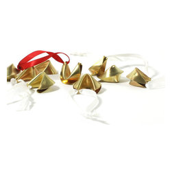 "Christina Kober - Fortune Cookie Ornament - Give the gift of good fortune with a fortune cookie ornament. A small hand formed brass fortune cookie hangs from a beautiful satin ribbon. The fortune cookie comes with a beautiful red ribbon.   cookie measures approximately 1 1/2"" x 1"" brass fortune cookie, treated to prevent tarnish Made in USA   Packaged in a protective pouch and white gift box. The gift box is tied with a ribbon making it perfect for gift giving."