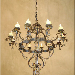 "Wrought Iron Chandeliers - Grand Entry Chandelier 58""H x 60""W plus canopy and hand-made 3/8"" solid square chain links. This grand entry chandelier was hand forged from wrought iron using 20 different material sizes to achieve the depth and detail need it. The chandelier has 12 medium base lights and 4"" resin candle covers"