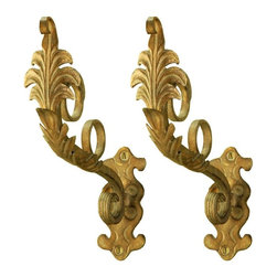 The Merchant Source - Metal Drapery Bracket - Elongated Leaf Design - Set of 2 (Gold) - Finish: Gold. Handsomely scaled and delicately detailed, this pair of drapery brackets show tradition at every turn. Made with forged metal, they have plentiful, popular finish color options for a customized look. 2 different return possibilities add interesting depth choices. Set of 2. Pictured in Gold finish. Made of Forged Metal. Fit up to 1.25 in. Rod. 3.5 in. and 6 in. return. Pair. 10 in. L x 3 in. W x 10 in. H (2 lbs.)