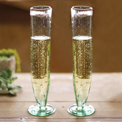 Recycled Glass Champagne Flutes - Set of 6 - Serve Bellinis or your favorite sparkling beverage in these slender Recycled Glass Champagne Flutes. Made of 100% recycled glass, each piece has a unique, extra tall silhouette that works well with rustic weddings and gatherings featuring modern yet charming table d�_�cor.