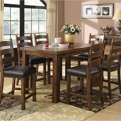 Emerald Home Chambers Creek 7 Piece Counter Height Dining Table Set Multicolor - - Shop for Dining Sets from Hayneedle.com! The Emerald Home Chambers Creek 7 Piece Dining Table Set is a gracious way to welcome friends and family. This tall-standing set makes chatting and casual meals comfortable. The set includes a table with built-in leaf and six chairs. All pieces are made of hardwood pine solids and oak veneers in a physically distressed weathered finish. The chairs have a gently curved ladder-back design padded seats upholstered in black bonded leather and nailhead trim for rustic charm. The centerpiece of the set is a classic farmhouse table with 20-inch built-in butterfly leaf to ensure easy seating for six or more.Dimensions:Table dimensions: 40-60L x 60W x 36H in.Counter stool dimensions (ea.): 19.7W x 23.6D x 41.3H in.About Emerald Home FurnishingsFounded in 1962 Emerald Home Furnishings supplies to home furniture retailers throughout the United States Canada Mexico Australia Japan Taiwan England and other countries. The company originally started as a distributor of bed frames and furniture and over the years has added a number of high-quality items to its product line. The company s mission is to strive for innovation integrity and excellent service.