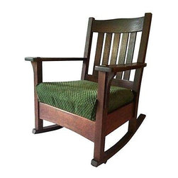 Early Mission Oak Rocker by J.M Young Circa 1910 - A splendid example of early-20th-century American Mission craftsmanship. Made by J.M Young, a renowned NY manufacturer, who also made pieces for Stickley. This chair is in wonderful condition, very sturdy, and will last another 100 years. Labeled, dates to the 1910s, and has a newly reupholstered wool blend seat.