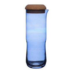 Aqua Fresh Carafe - The Aqua Fresh Carafe reminds us of endless summer days, but it's also perfect for everyday use. The cool blue mouth-blown glass will enhance any beverage, and the cork cover tops off the piece for a look reminiscent of a country escape.