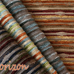 Calvin Fabrics' Horizon - Sculpted chenille Horizon features undulating lines reminiscent of distant mountains reflected on the water in a tight repeat resulting in a semi-regular horizontal stripe for upholstery use. Nuances in the nap create instances of light and shadow, matte and sheen and high-low relief between colorful, plush chenille elements and low-lying neutral background. These distinct design elements enhance the visual impact of the fabric, while rich colors in carefully crafted groupings evoke images of cliffside villages and coastal cottages, mountain lodges and desert oases.   In Tuscan Sun, blue – in shades of sky and cornflower – alternates with kiwi and deep orange to produce a festive and refreshing pattern recalling Mediterranean villas; while the muted blues in Coastal Mist offer tempered tones of slate, ice and teal punctuated with taupe for a distinctly moody northern coast feel.  A palette of gold, burnt sienna, tawny and ochre establishes a Southwestern vibe in Autumn Vista, while steel, navy, avocado and burgundy command a dramatic presence for Mountain Dusk.