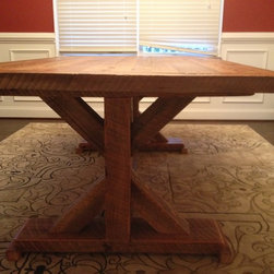 "Reclaimed Barn Wood Trestle Table - Custom one of a kind Trestle dining table with Extension leafs on the ends. Table is built with genuine reclaimed barn wood taken from the North Georgia area. This design features 4""x 8"" main columns and a 2"" thick table top with matching leaves."