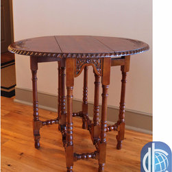 """International Caravan - International Caravan Hand-Carved Mahogany Drop-Leaf Oval Table - Add a touch of classic elegance to your home furnishings with this drop-leaf oval table, featuring a """"Windsor"""" carved wood style, a Walnut stained finish, and a drop-leaf table deployment design for ease of storage and use."""