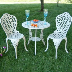 Mississippi 3 piece Bistro Set - Enjoy life at a slower pace with the classic Southern styling of the Mississippi Bistro Set. The table and chairs feature lattice and scrolled serpentine patterns throughout. Seat height is 18 inches and dips slightly in the center for maximum comfort. Bowed legs with intricate detail support each piece, and the table top features 1.5-inch diameter hole for a small to medium umbrella*. The circular element connecting the table legs provides additional table and umbrella support so you can use this set outdoors with confidence. Feet on all pieces feature rubber trivets underneath to protect your patio surface.Sturdy and solid, this bistro set is crafted from 100% cast aluminum, which is perhaps the most worry-free metal for outdoor furniture. Pieces are fastened with stainless steel fastening hardware, which will resist rust and corrosion. Available in your choice of several attractive weather-resistant finish options.Assembly is simple and requires only two tools: a Phillips screwdriver and a wrench. Estimated time of assembly for the set is 60 minutes. *Recommended umbrella size for coverage is at least 6 ft.