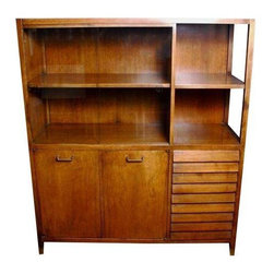 Pre-owned 1960s American Modern Walnut China Cabinet - This 1960s American Modern Walnut China Cabinet has brass pulls and feet. There are two sliding glass doors on the left side above the two cabinet storage space, and four drawers (two slats per drawer) to the right below two sections of open storage. The cabinets on the left side open to reveal roomy storage space divided by one shelf. There is age-appropriate patination to the brass, but the unit itself is in excellent, vintage condition.