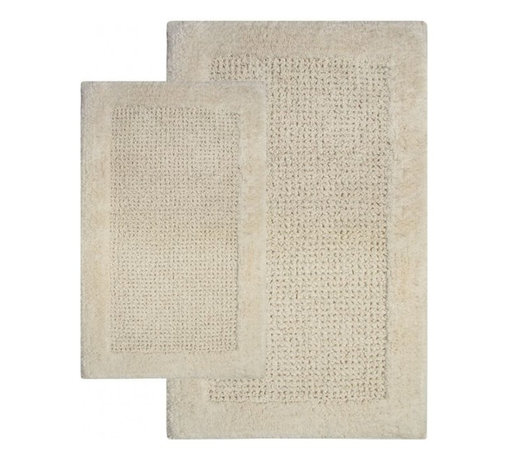 "Chesapeake Merchandising - 2 Piece Naples Bath Rug Set in Ivory - Softness and Plush, The Naples Collection adds luxury to any bathroom.  This bath rug is Spun from 100% Cotton.  This bath rug is plush under foot and comes in 4 colors to coordinate with your bathroom decor.  This bath rug set includes a 21""x34"" and 24""x40"" Bath Rug. Machine Tufted with anti skid spray latex back. Dimensions: 21""W X 34""L and 24""W X 40""L; Color: Ivory; Material:  Cotton; Shape: Rectangular; Construction: Machine Tufted and Powerloom"