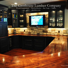 Traditional Wine Cellar by The Grothouse Lumber Company