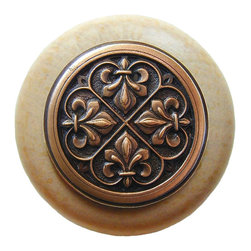 "Inviting Home - Fleur-de-Lis Natural Wood Knob (clear finish with antique copper) - Fleur-de-Lis Natural Wood Knob in clear finish with hand-cast antique copper insert; 1-1/2"" diameter Product Specification: Made in the USA. Fine-art foundry hand-pours and hand finished hardware knobs and pulls using Old World methods. Lifetime guaranteed against flaws in craftsmanship. Exceptional clarity of details and depth of relief. All knobs and pulls are hand cast from solid fine pewter or solid bronze. The term antique refers to special methods of treating metal so there is contrast between relief and recessed areas. Knobs and Pulls are lacquered to protect the finish. Alternate finishes are available. Detailed Description: The Fleur-de-lis means ""flower of the lily"" It was used to represent French royalty. It was said that the king of France Clovis who started using the symbol of the Fleur-de-lis because the water lilies helped guide him to safety and aided him in winning a battle. The design in the Fleur-de-Lis pulls is arranged in alternating positions of the Fleur-de-lis. These pulls are a great match for the Fleur-de-lis knobs which have the Fleur-de-lis pattern arranged in a circle. The different shapes of decorative hardware make the cabinet doors and drawers interesting to look at."