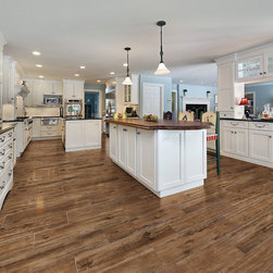 """Marazzi USA Porcelain Wood Tile - Finely rectified wide-plank sizes – 6""""x36"""" and 9""""x36"""" – facilitate minimal grout joints and stretch the line of sight along the 36"""" lengths. The minimal undulation accommodates a top-set baseboard without gap issues."""