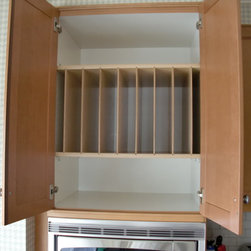 Above Fridge & Oven Tray Dividers - Install tray dividers in the cabinet above your refrigerator or oven.  By placing the dividers in the middle of the cabinet, you now have  a shelf above and below the dividers.  Great use of space.