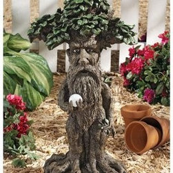 Design Toscano Treebeard Ent with Mystical Orb Statue - Your own Treebeard to protect your part of the forest. The Design Toscano Treebeard Ent with Mystical Orb Statue is perfect for any Lord of the Rings fan. It's artistically carved from designer resin and has amazing detail. Treebeard and his orb are hand-painted and designed to weather the elements beautifully.About Design ToscanoDesign Toscano is the country's premier source for statues and other historical and antique replicas, which are available through the company's catalog and website. Design Toscano's founders, Michael and Marilyn Stopka, created Design Toscano in 1990. While on a trip to Paris, the Stopkas first saw the marvelous carvings of gargoyles and water spouts at the Notre Dame Cathedral. Inspired by the beauty and mystery of these pieces, they decided to introduce the world of medieval gargoyles to America in 1993. On a later trip to Albi, France, the Stopkas had the pleasure of being exposed to the world of Jacquard tapestries that they added quickly to the growing catalog. Since then, the company's product line has grown to include Egyptian, Medieval and other period pieces that are now among the current favorites of Design Toscano customers, along with an extensive collection of garden fountains, statuary, authentic canvas replicas of oil painting masterpieces, and other antique art reproductions. At Design Toscano, attention to detail is important. Travel directly to the source for all historical replicas ensures brilliant design.