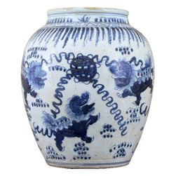 """Oriental Danny - Blue and White Porcelain Vase - This hand painted blue and white porcelain vase has rich deep blue colors. The pattern is painted with lions (foo dogs) that symbolizes lucky and guard against evil spirit. The wide opening of this vase is great for flower arrangement. Measures 14L X 14W X 16H. The vase opening diameter 8""""."""