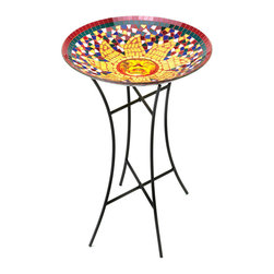 KOOLEKOO - Radiant Sun Birdbath - The colorful mosaic bowl and the sleek, modern metal stand make this birdbath a contemporary classic. The wise face of this sun surrounded by jewel-toned tiles will brighten the water, attracting birds to take a break from flitting and flying to cool off in your yard.