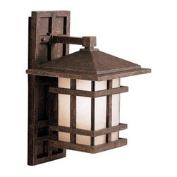 Kichler Cross Creek Outdoor Wall Lantern - 16H in. Aged Bronze - High-quality cast aluminum makes Kichler Cross Creek Outdoor Wall Lantern is a durable piece that will last for years of outdoor use. The mission-style frame is hand-painted with an aged bronze finish and given a diffused textured-glass insert creating a look that will remain relevant and stylish for the life of the fixture. The lantern features a removable rectangular backplate for easy installation and is UL-approved for outdoor use in wet conditions.About Kichler LightingSince 1938 Cleveland-based Kichler Lighting has been known for its innovative designs and excellent craftsmanship. Kichler is the world's leading decorative lighting fixture company and the winner of four ARTS Lighting Manufacturer of the Year awards. Kichler designers travel the world to discover the latest trends in exterior and interior style colors and designs. Then they translate the best of those trends into fixtures that will bring beauty pleasure and light into your home. Kichler fixtures stand the test of time and are functional works of art that you're sure to treasure.