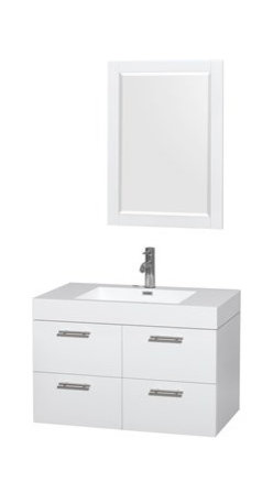 """Wyndham Collection(R) - Amare 36"""" Wall-Mounted Bathroom Vanity Set With Integrated Sink by Wyndham Colle - The Wyndham Collection is an entirely unique and innovative bath line. Sure to inspire imitators, the original Wyndham Collection sets new standards for design and construction. The Amare wall-mounted vanity family delivers beautiful wood grain exteriors offset by modern brushed chrome door pulls. Each vanity provides a full complement of storage areas behind sturdy soft-close doors and drawers. This versatile vanity family is available with distinctive vessel sinks or sleek integrated counter and sinks to fulfill your design dreams. A wall-mounted vanity leaves space in your bathroom for you to relax. The simple clean lines of the Amare wall-mounted vanity family are no-fuss and all style. Amare Bathroom Vanities are available in multiple sizes and finishes.FeaturesConstructed of the highest grade MDF, engineered for durability to prevent warping and last a lifetime 8-stage preparation, painting and finishing processHighly water-resistant low V.O.C. sealed finishUnique and striking contemporary designModern Wall-Mount DesignMinimal assembly requiredDeep Doweled DrawersFully-extending soft-close drawer slides Concealed soft-close door hinges Backsplash not availableAcrylic-Resin integrated sink Rectangular Sink Single-hole faucet mountFaucet(s) not includedMirror includedMetal exterior hardware with brushed chrome finish Two (2) functional doors Two (2) functional drawers Plenty of storage spacePerfect for small bathrooms and powder roomsIncludes drain assemblies and P-traps for easy assembly How to handle your counter Spec Sheet for Vanity Installation Guide for Vanity Spec Sheet for MirrorInstallation Guide for Mirror Spec Sheet for Amare Rotating Wall Cabinet with Mirror (WC-RYV202) Spec Sheet for Amare Bathroom Wall Cabinet (WC-RYV205)Installation Guide for Amare Bathroom Wall Cabinet (WC-RYV205) Spec Sheet for Amare Bathroom Wall Cabinet (WC-RYV207-WC)Inst"""