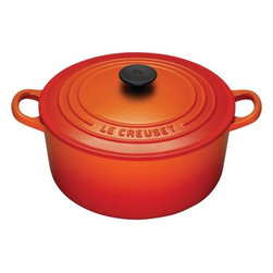 Le Creuset - Enameled Cast Iron 4 1/2-Qt. Round Dutch Oven - For generations, families have come to cherish this everyday French Oven (or Dutch oven, referred by most people). Ideal for simmering, marinating, poaching, braising, and browning; this piece moves from the stove or oven to the table and can store leftovers in the refrigerator or freezer! The tight fitting lid creates a blanket of heat, sealing in flavor and moisture, and is equipped with a phenolic knob which is oven safe up to 480 Degrees F. The Le Creuset enameled cast iron pieces evenly spreads heat and retains heat longer than other cookware materials. Features: -Dutch oven.-Material: Enameled Cast Iron.-Round shape.-Enhanced handles are 45% larger, distributes the weight evenly and easier to grip when wearing oven mitts.-Improved ergonomic knob, for easier grip, and now resistant up to 480 degrees.-Phenolic knob is oven safe to 480°F.-Lid traps heat and seals in flavor and moisture.-Works well on all heat sources, including induction and oven safe.-Ideal to use when making soups, rice dishes, casseroles, roasts, quiches, one pot meals, baked recipes, desserts, cakes and breads.-Refrigerator and freezer safe.-Dishwasher safe, but Hand washing is recommended.-Capacity: 4 1/2-Qt..-Provides even heat distribution and superior heat retention; colorful exterior enamel resists chipping and cracking.-Advanced sand-colored interior is durable, makes it easy to monitor food as it cooks to prevent burning or sticking.-Collection: Enameled Cast Iron.-Distressed: No.-Country of Manufacture: France.Dimensions: -Dimensions: 3.25'' H x 7.13'' W x 7.13'' D.-Overall Product Weight: 10.2 lbs.Warranty: -Lifetime limited warranty.