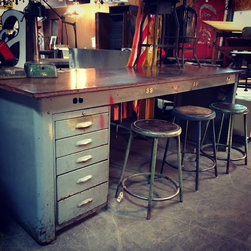 Society of Salvage - Reclaimed from local factory.  This workbench with the sleek deco design offers great storage and amazing work-space.  Built-in plugs.  Being sold as is however I'm not sure if I'd paint it, love the patina.  The top could be replaces with a nice butcher block or reclaimed wood top.