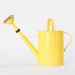 Sunny Side Watering Can - Who's day wouldn't start off sunny when using this yellow watering can? I love the bright poppy color, and a bonus is that you'll be able to find it in a cluttered garage.