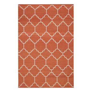 """Arabesque rug in Saffron - """"A classic tile pattern from the middle east and northern Africa, it's one of my go to mosaics in flooring. By switching mediums and using it on a rug gives it new life."""" -Genevieve Gorder"""