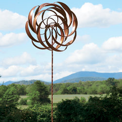 Kinetic Garden Art - This piece is rather large but very delicate at the same time. The intricate pattern of circles all spin independently to create constant motion. I love the brass finish and think it would look beautiful set in the middle of a flower bed.