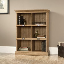 Sauder Barrister Lane 3-Shelf Bookcase - Scribed Oak - The Sauder Barrister Lane 3-Shelf Bookcase – Scribed Oak brings a cleaner, more contemporary look to the classic barrister-style bookcase, with a scribed oak finish that honors its traditional inspirations. Constructed from quality, high-density particleboard, this versatile bookcase is suitable for both storage and display, and comes with a five-year limited warranty from Sauder.About SauderSauder is North America's leading producer of ready-to-assemble (RTA) furniture and the nation's fifth largest residential furniture manufacturer. Based in Archbold, Ohio, Sauder also sources furniture from a network of quality global partners, including a line of office chairs that complement its residential and light commercial office furniture. Sauder markets more than 30 distinct furniture collections in a full line of RTA furnishings for the home, entertainment, home office, bedroom, kitchen, and storage.Sauder is a privately held, third-generation, family-run business. The company prides itself on its awareness that all function and no fashion makes for a dull living space when it comes to home furnishing products. That's why Sauder's award-winning design team has produced more than 25 collections of stylish furniture that span the design spectrum. From minimalist modern or contemporary to classic 18th century or country styles, Sauder has what you're looking for. The company offers more than 500 items - most priced below $500 - that have won national design awards and generated thousands of letters of gratitude from satisfied consumers.