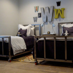 The Twins Bed - These great welded bed frames on wheels are perfect for lofts or studios.