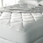 TRUMP Home - TRUMP Home 400 Thread Count Egyptian Cotton Luxury Deep Pocket Mattress Pad - Bring luxurious comfort to your bedding with this plush 400 thread count Egyptian cotton mattress pad. Machine washable and filled with hypoallergenic polyester,this mattress pad features a 20-inch skirt depth to fit even large mattresses.