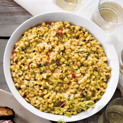 """Alewel's Country Meats - Alewel's Country Meats Bourbon Creamed Corn - Exclusively ours. Creamed yellow corn seasoned with garlic, shallots, black pepper, red bell peppers, chives, and bourbon arrives in a 9"""" reusable ceramic dish. Each 2-pound order serves 8–10; approximately 3.2&#4 ounces per serving. Dish will va..."""