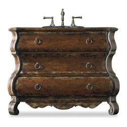"Cole & Co. - Cole & Co. 47"" Designer Series Collection Edwards Bombe Chest - Distressed Cherr - Cole & Company combines great design with great flexibility, allowing you to mix and match size, finish, and style to create your own perfect bathroom vanity. The Edwards Bombe Sink Chest is a stately piece but with graceful curves and detailing. Two of the three drawers are available for storage. Hardwood solids with cherry veneers are handpainted and distressed. Drawer puls are finished in an antique bronze. Your Cole & Co. quality vanity is a significant investment expected to last for generations. To maintain its beauty and help it last, please refer to the Custom Collection product information sheet and the Care & Cleaning FAQ. Each piece is handmade and finished and actual color may vary. Information regarding the return policy of your Cole & Co. product is available here. If you have any questions, please contact us before ordering. Features: Completely hand made Distressed Cherry Two of the three drawers are available for storage 47 1/4""W x 19 1/4""D x 34 1/2""H Faucet(s) not included Sink(s) not included How to handle your counter View Spec Sheet"